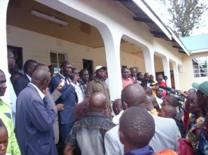 Migori County Speaker Gordon Ogolla (holding the mic) address a crowd at Assembly ground at a past event