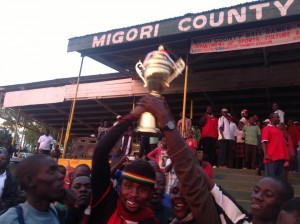 Rongo sub-county winners of the county tournament celebrate with a trophy