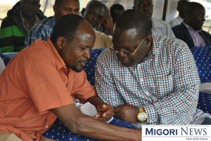 Migori governor Okoth Obado (L) and Nyatike MP Edick Anyanga at Okenge Primary School during a past event
